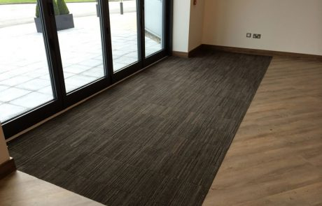 barrier matting made from recycled tyres and vinyl floor tiling in new build office on AMP