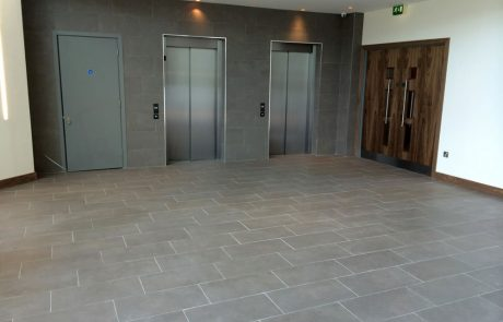 ceramic porcelain tiles near lifts in new build on AMP