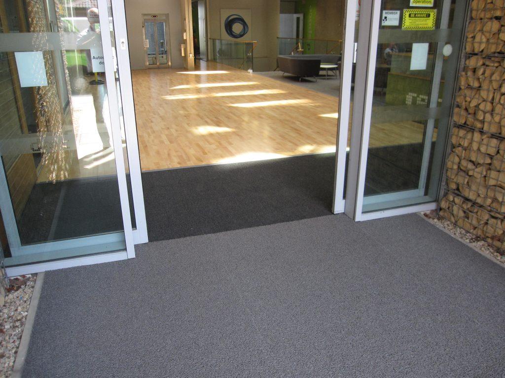 A Cumberlidge install new flooring at the Digital Media Centre in Barnsley