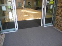 A Cumberlidge install new flooring at the Digital Media Centre in Barnsley