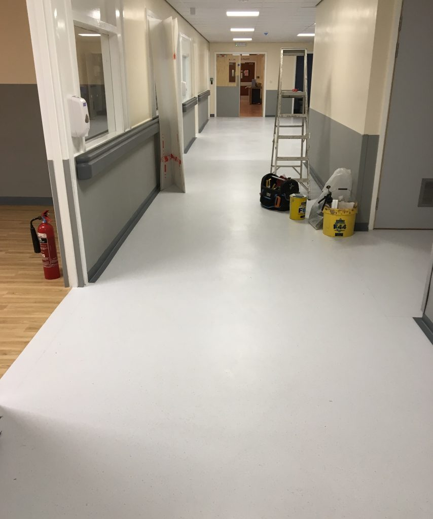 After: the same corridor in ward B10 now featuring Polyflor Palettone in Morning Air