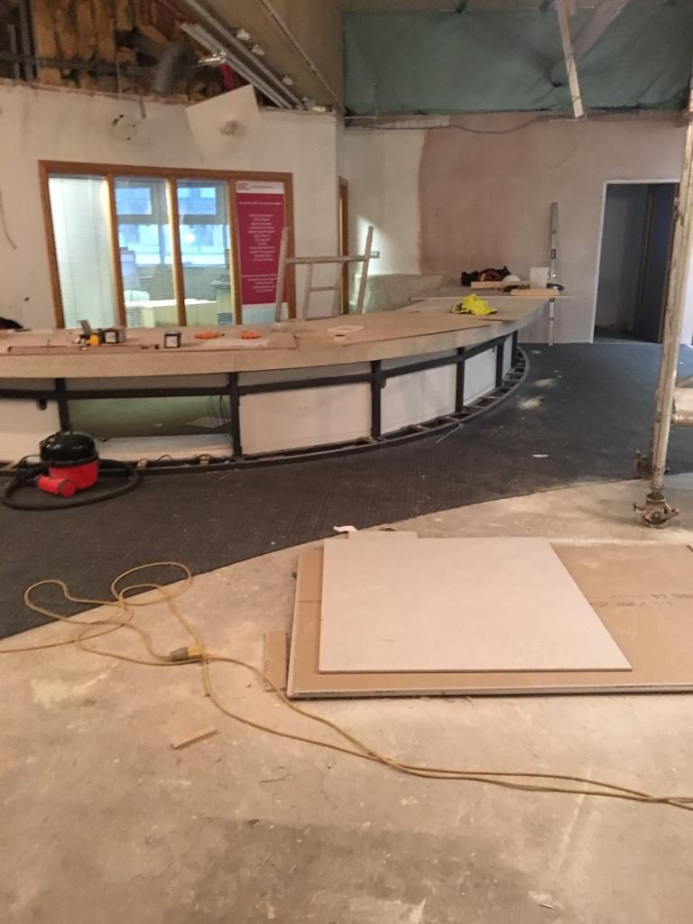 Before: the 'Hallam' Help' area during the uplifting of the existing carpet tiles which were saved for re-use