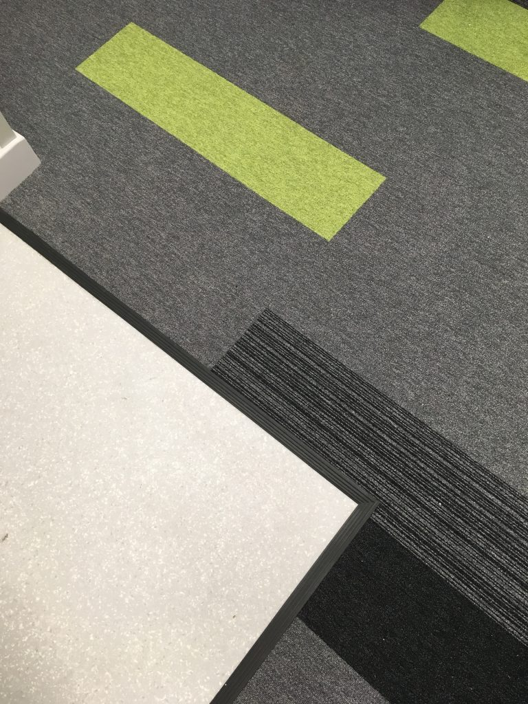 A closer look at the Forbo Tessera floor tiles inside the Patient's Booking Hub
