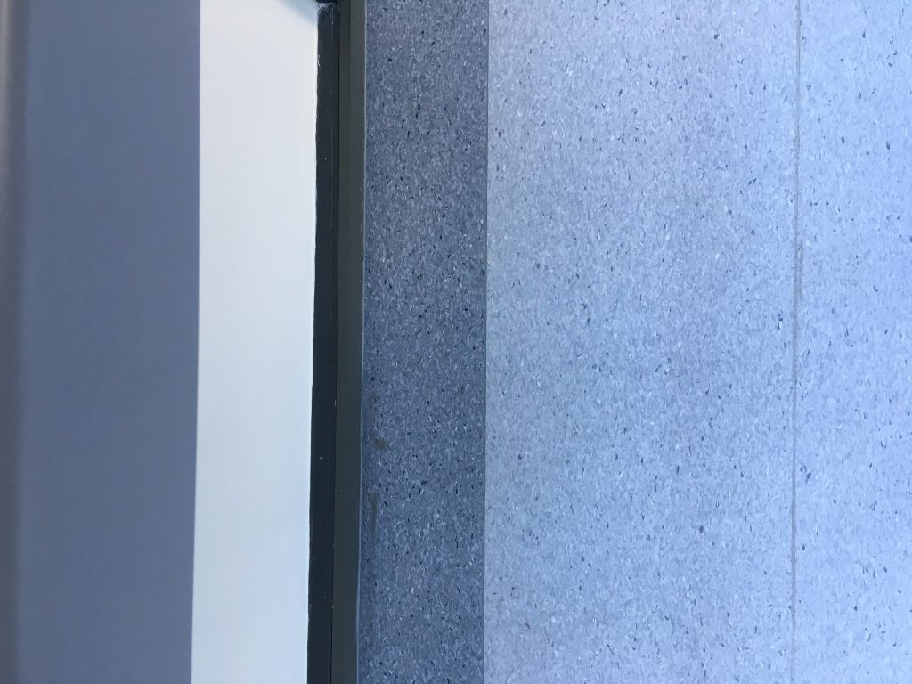 Tarkett IQ Granite sheet vinyl in Colour 382 and Colour 381 are used to create a contrasting border for the main walkway