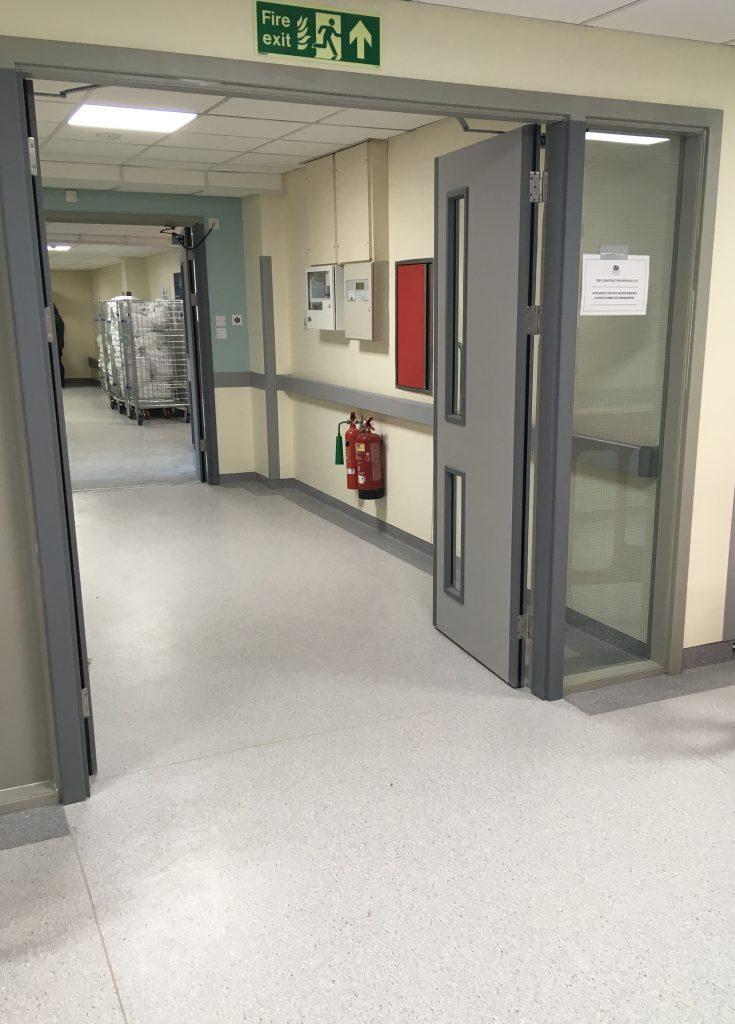 After: The corridor entrance with new flooring