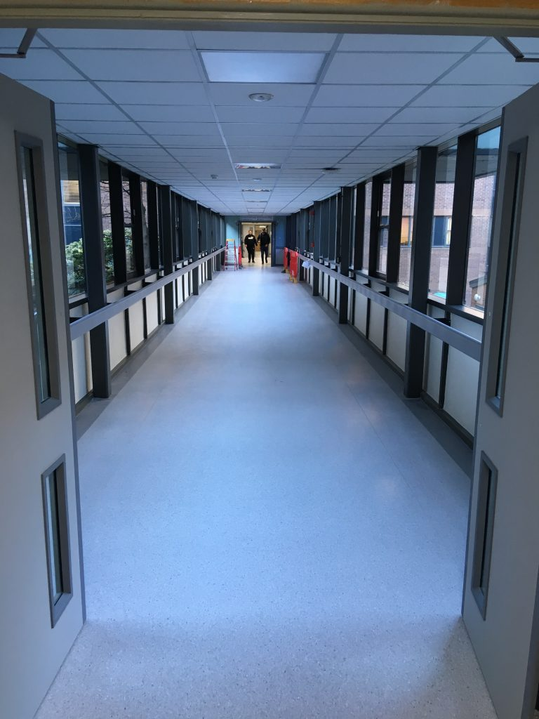 After: The corridor entrance and corridor as work is completed - a total transformation!